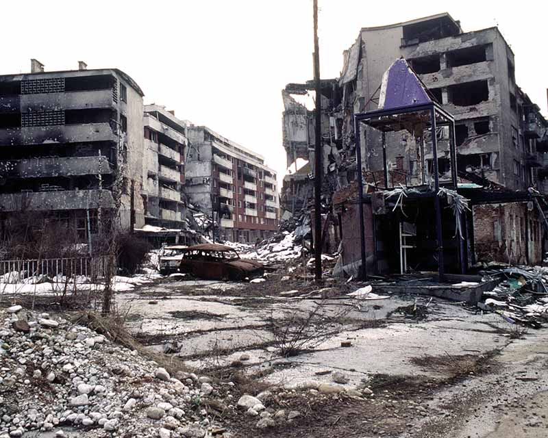 Bombed and burned out Sarajevo street image